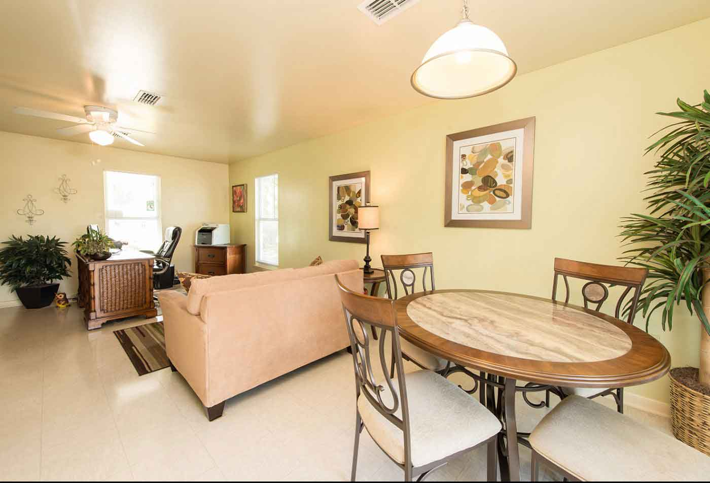 Spacious living and dining room at Peary Court at Key West Apartments | Key West Apartments