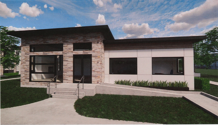 Modern style exterior building with large sleek glass windows and a glass double door entrance. Wheelchair access ramp located on the right side of the building, and steps located in the front of the building surrounded by green grass and