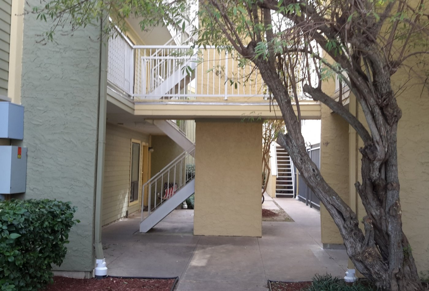 Two story apartment complex at Carelton Courtyard apartments in Galveston TX