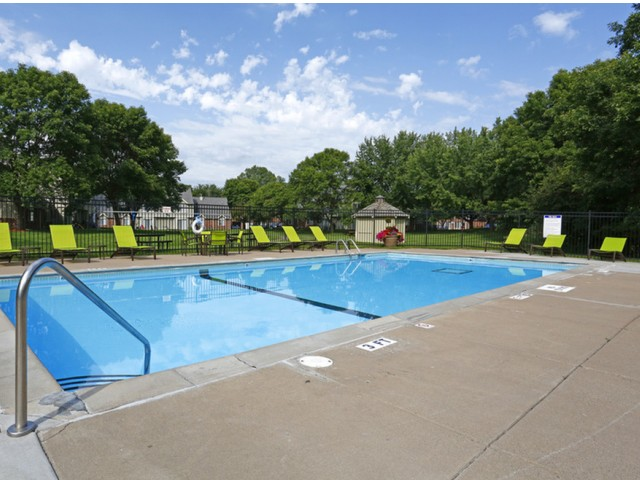 Image of Outdoor heated swimming pool with sundeck for Birch Lake Townhomes