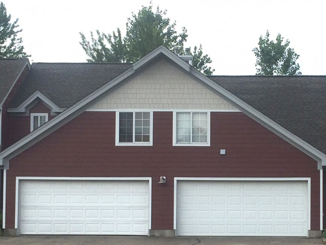 Image of Attached, double-car garage for Mequon Trail TH
