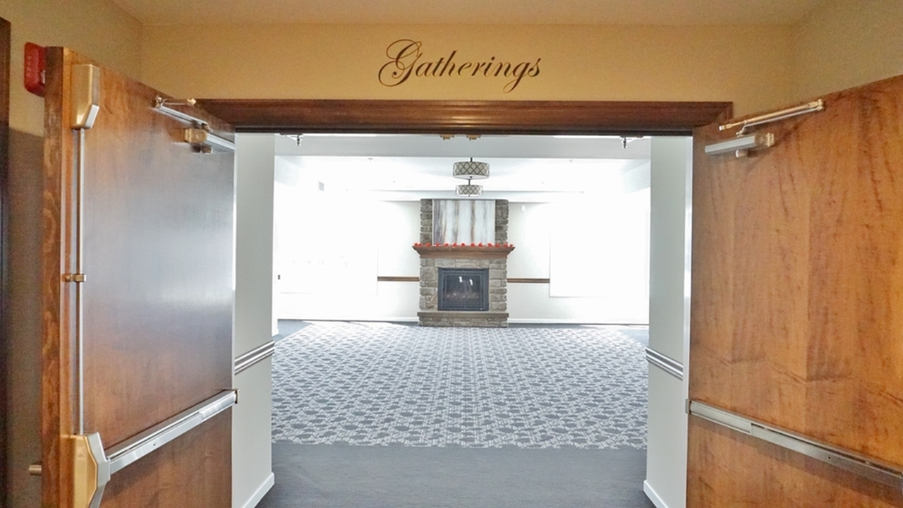 The Belvedere Apartments, interior, community gathering room, large fire place, carpet