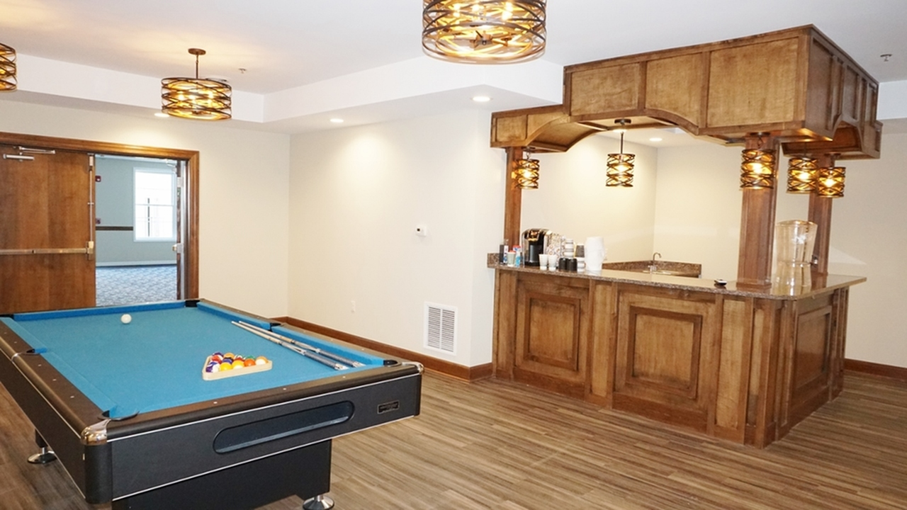 The Belvedere Apartments, interior, billiard room and pub, wood flooring, spacious