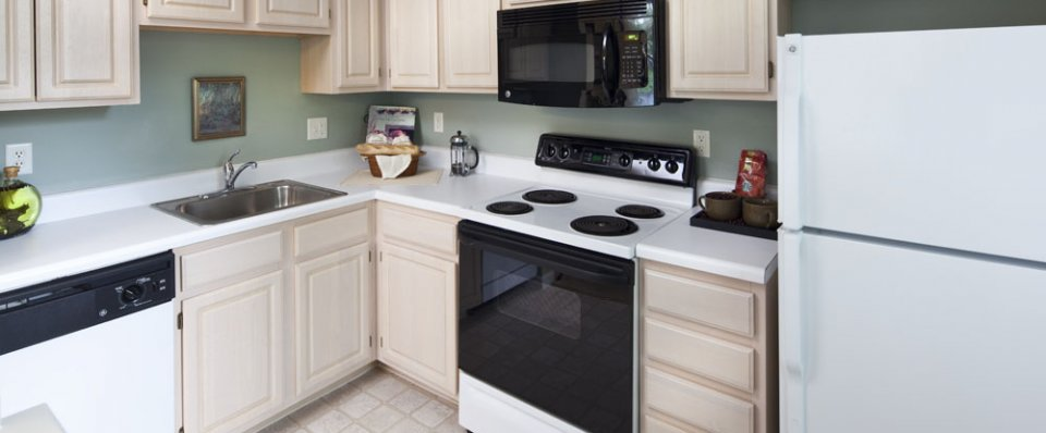 Spacious kitchens of our West Warwick apartments for rent at Greenwich Place