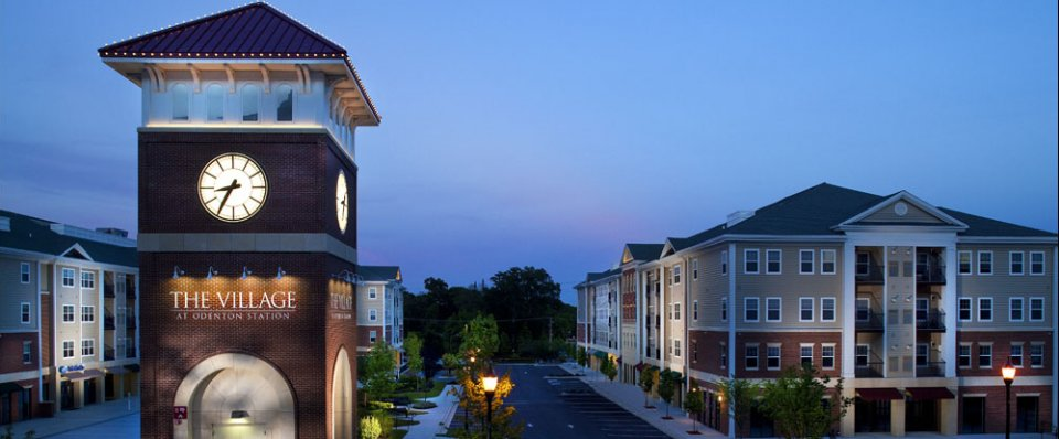 Clock tower and courtyard of apartments near Fort Meade
