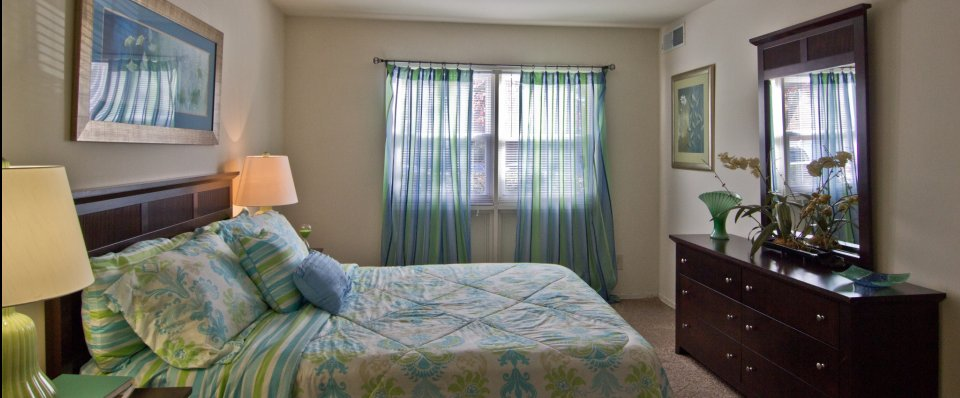 Inviting bedroom interiors for our apartment homes for rent in Norfolk VA at The Gates of West Bay
