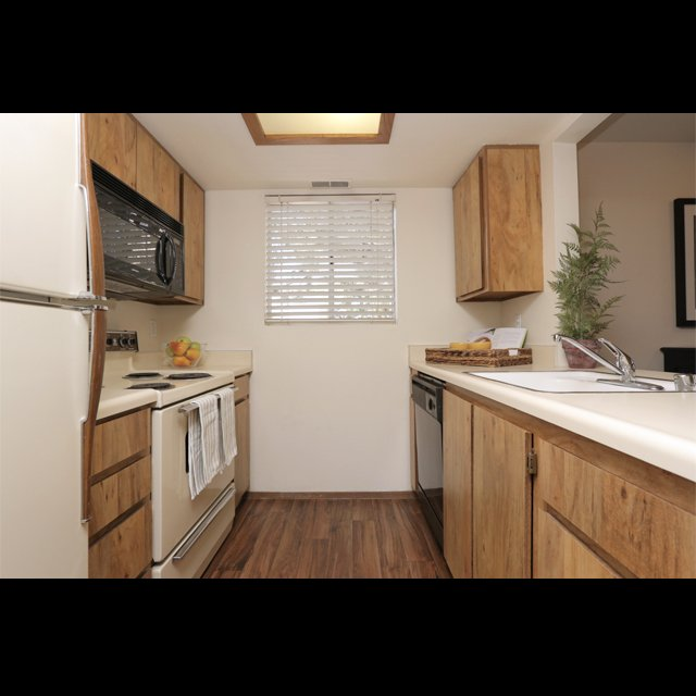 Kitchen with hardwood floors of West Valley apartmentscenter at apartments in west valley city ut