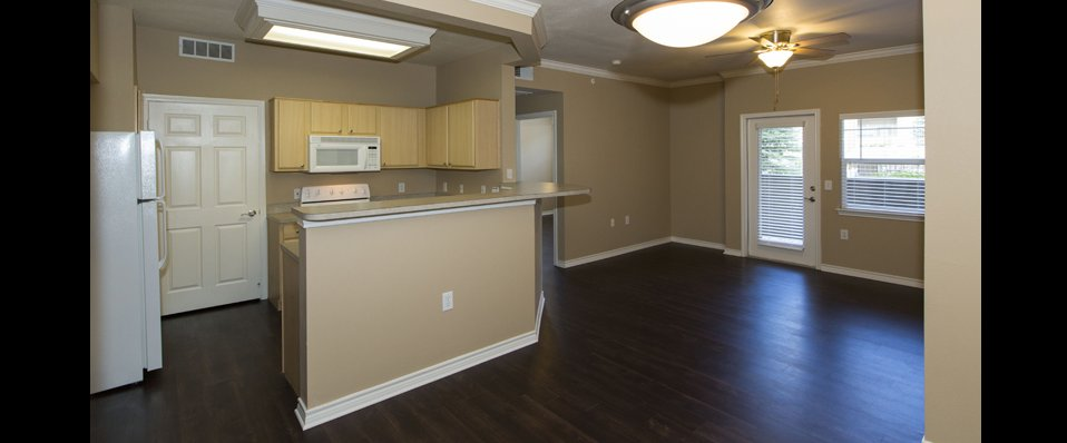 Gleneagle apartments with open kitchen and living room