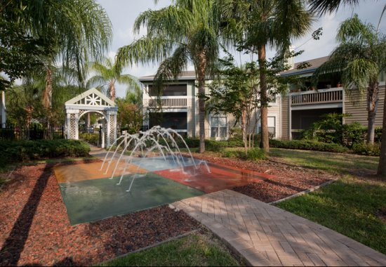 fountain and pathway at Palm Cove Apartments in Bradenton Florida
