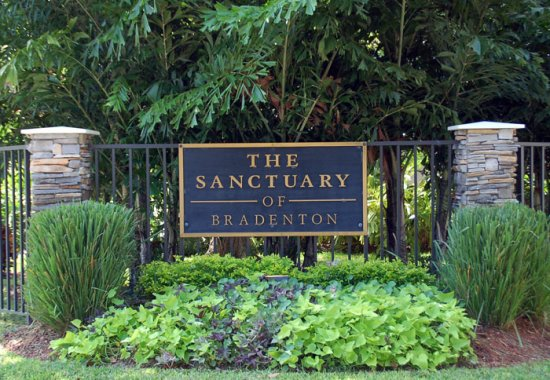 Sanctuary of Bradenton apartments front entrance and sign