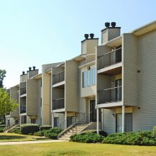 Apartment rentals exterior building and lake in Fayetteville, North Carolina
