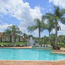 Apartment rentals exterior building and pool in Naples, FL