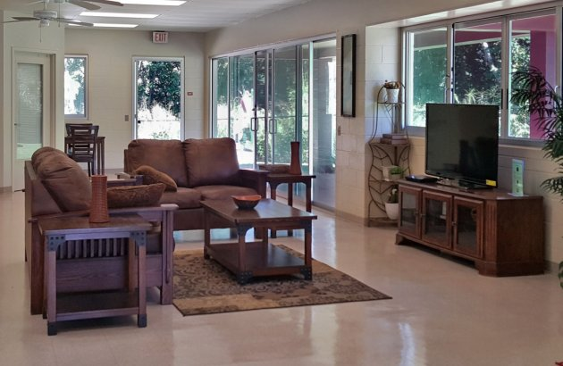 Enjoy the cozy seating areas in our community room.