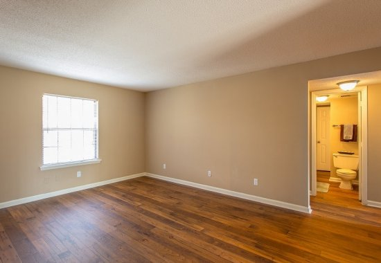 Unit with hardwood floors at The Ledford at Hamilton Place in Chattanooga, Tennessee