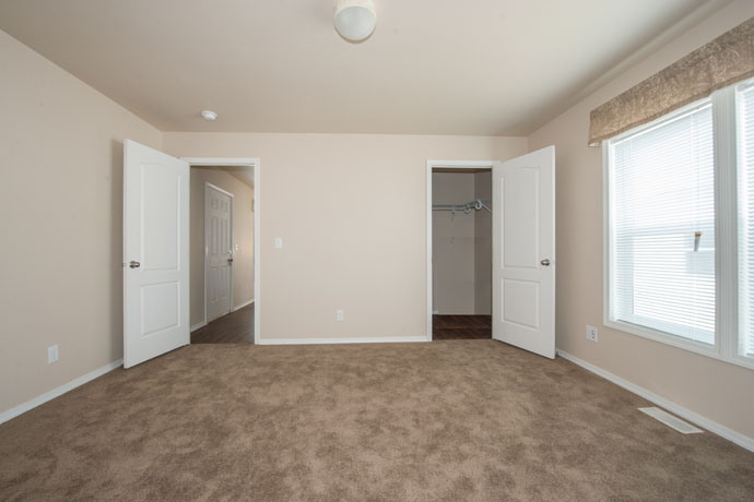 picture of large apartment bedroom big window