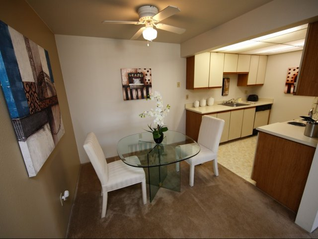 picture of apartment dining room and kitchen with ceiling fan