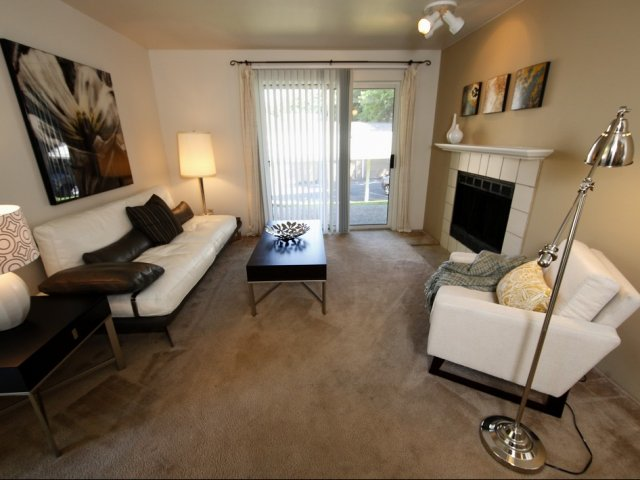 picture of living room with fireplace and balcony patio doors