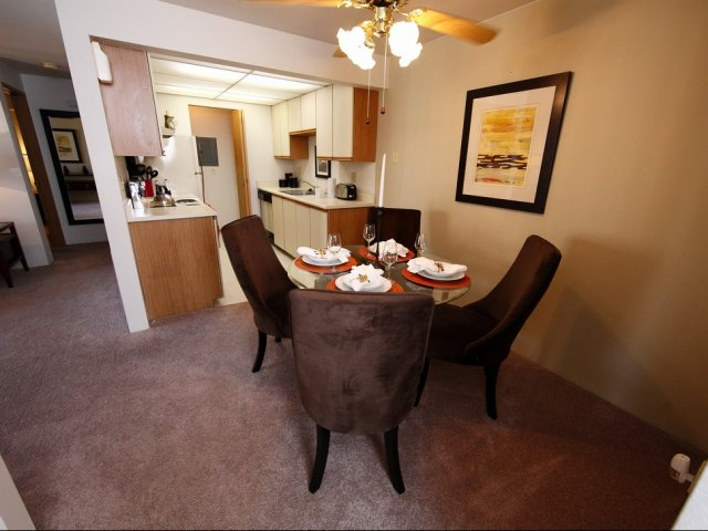picture of dining room with ceiling fan