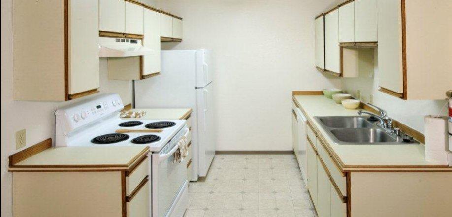 apartment kitchen refrigerator stove dishwasher