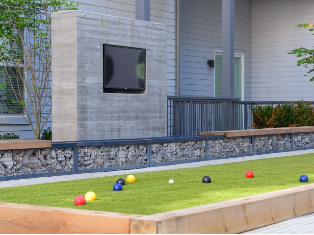 Image of Outdoor entertainment spaces with TVs, a fireplace, Ping-Pong and a Bocce court for pre-gaming or the after party for The Cleo East Nashville