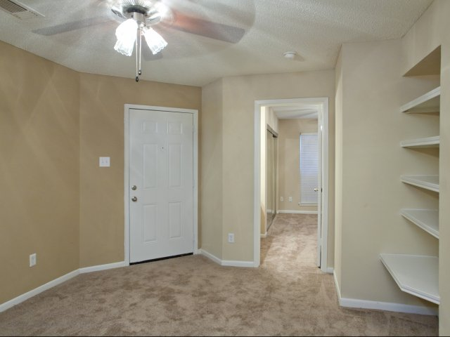 Arbors of Wells Branch Apartments for Rent in Austin, TX | Living Room with Built-In Desk