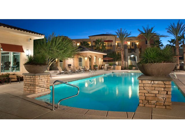 The Residences at Village Stadium in Surprise, AZ Apartments For Rent | Pool at Night