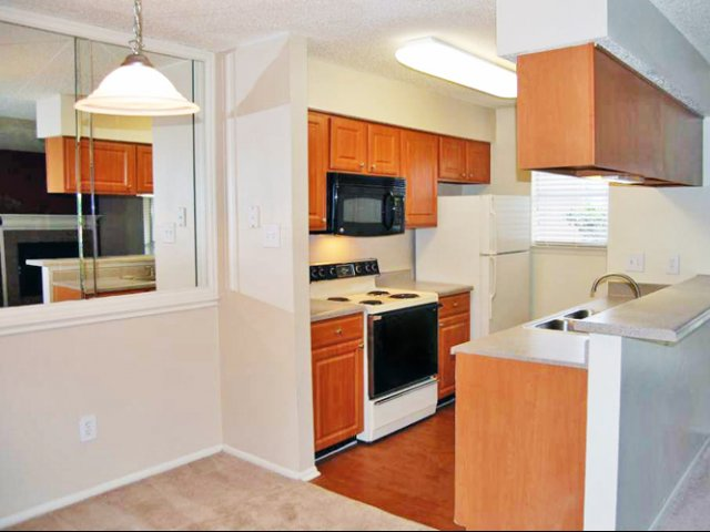Costa Del Sol | Apartments for Rent in San Antonio, TX | Kitchen with Cherry Cabinetry