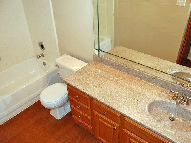 Costa Del Sol | Apartments for Rent San Antonio, TX | Bathroom with Cherry Cabinets