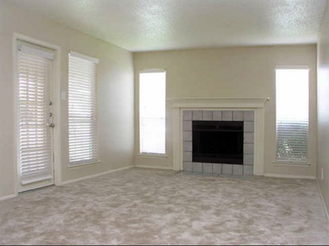 Costa Del Sol | Apartment Rentals in San Antonio, TX | Living Room with FIreplace