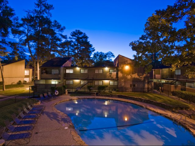 Trailwood Village Apartments for Rent in Kingwood, TX | Pool at Night