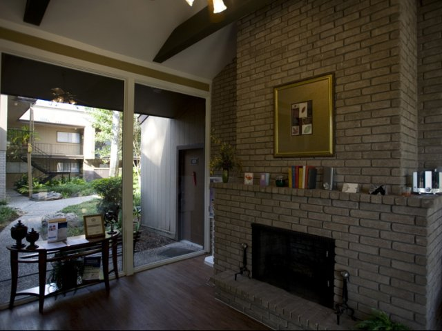 Trailwood Village Apartments for Rent in Kingwood, TX | Leasing Center Fireplace