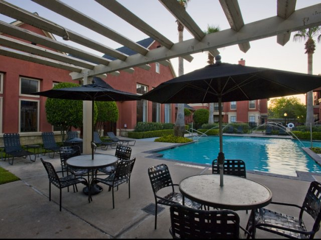 The Retreat at Eldridge Apartments for Rent in Houston, TX | Sundeck by Pool
