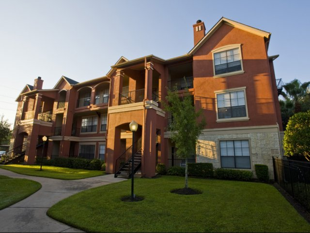 The Retreat at Eldridge Apartments for Rent in Houston, TX | Building at Desk