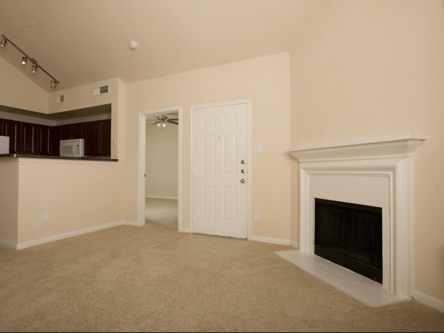 The Retreat at Eldridge Apartments for Rent in Houston, TX | Living Room with Fireplace