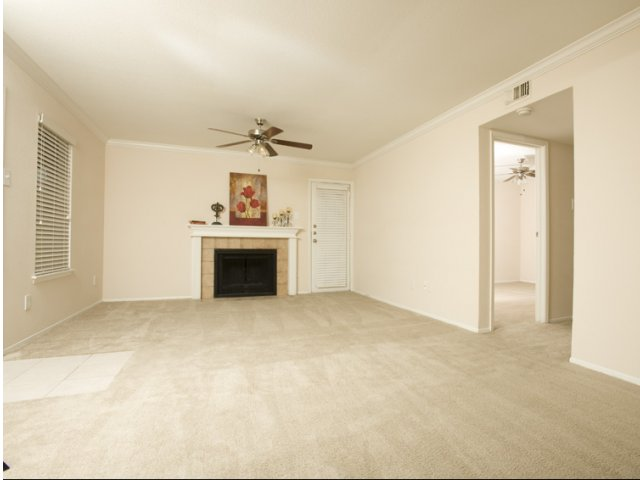 Cimarron Parkway | Apartments For Rent in Katy, TX | Living Room with Wood Burning Fireplaces