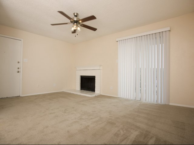 Hunt Club at Pin Oak | Apartments For Rent in Katy, TX | Living Room with Fireplace