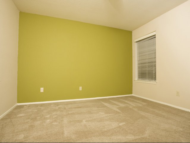 Brandon Oaks | Cypress, Texas Apartments for Lease | Bedroom with Accent Walls