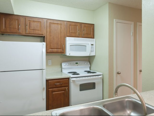 Canyon Ridge | Apartment Rentals in Rockwall, TX | Kitchen with Maple Wood Cabinetry