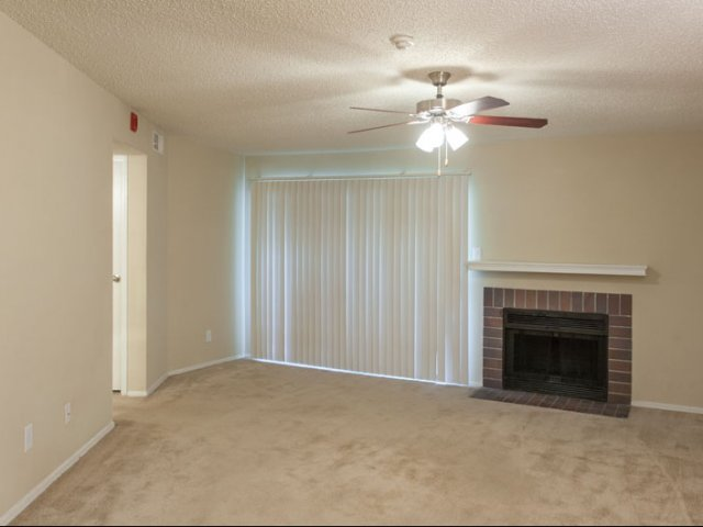 Springfield | Apartments for Rent in Mesquite, TX | Living Room with Fireplace