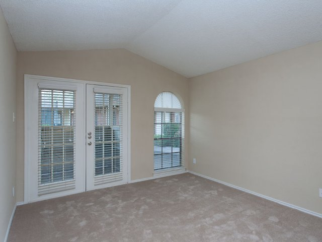 Summers Crossing Apartments for Rent in Plano, TX | Living Room with French Doors