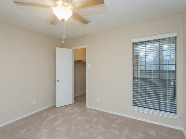 Summers Crossing Apartments for Rent in Plano, TX | Bedroom with Closet and Window