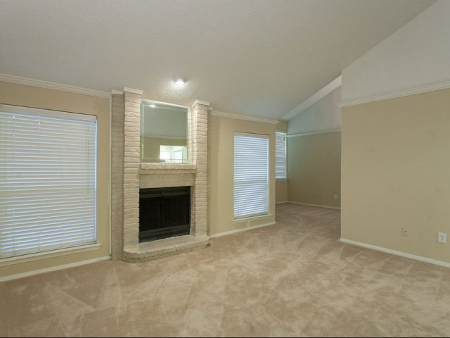 Preston Greens | Apartments For Rent in Dallas, TX | Living Room with Fireplace