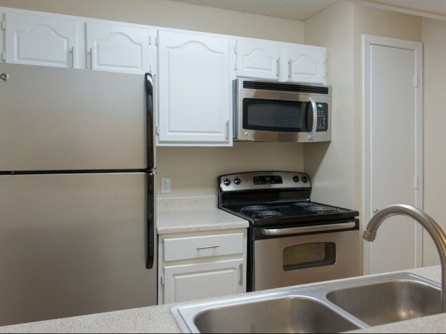 Preston Greens | Apartments For Rent in Dallas, TX | Kitchen Cabinets and Appliances