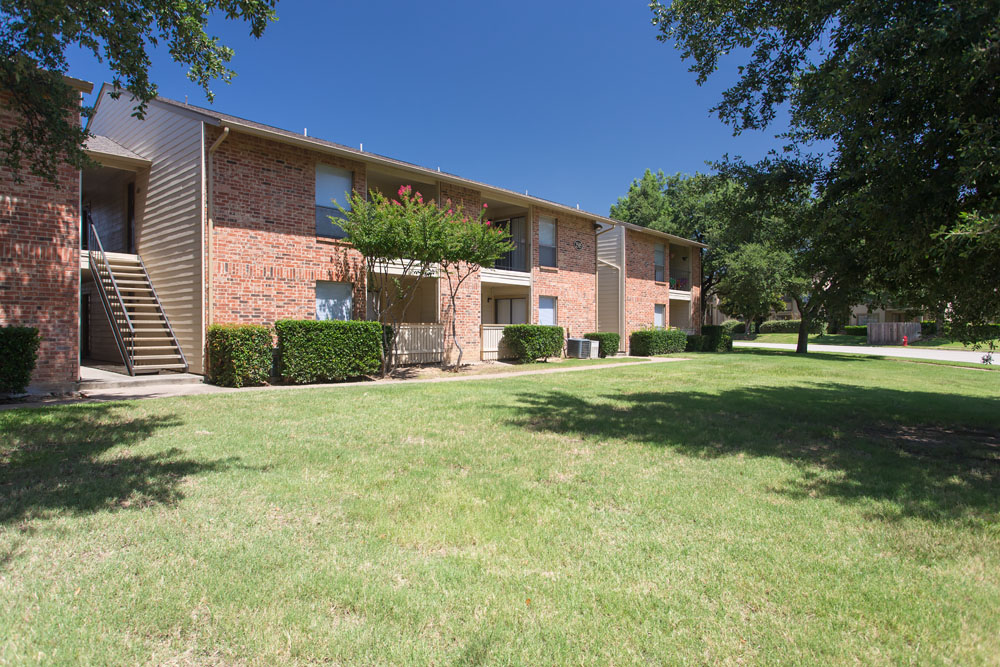 Woods of Bedford Apartments for Rent in Bedford, TX | Walkway with Bench