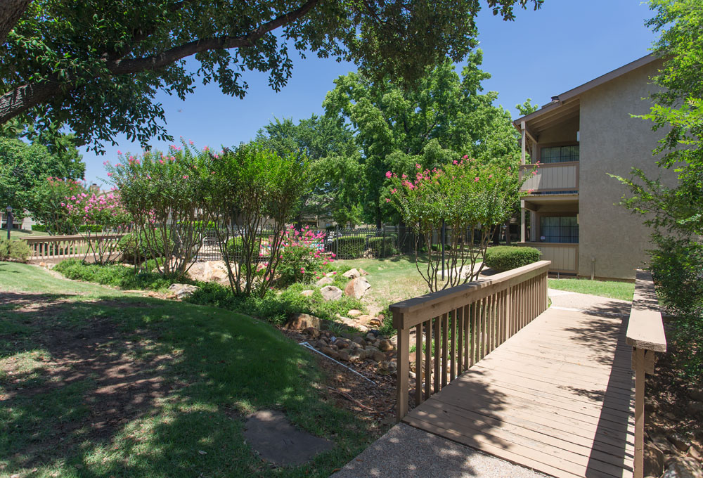 Woods of Bedford Apartments for Rent in Bedford, TX | Creek with Bridge