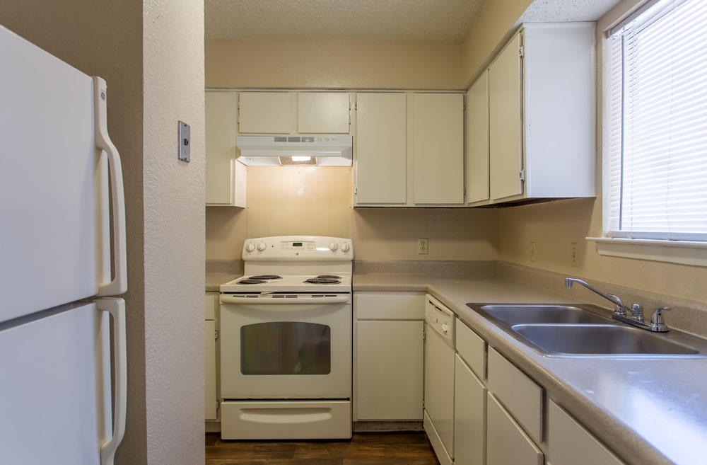 Woods of Bedford Apartments for Rent in Bedford, TX | Kitchen with Counter