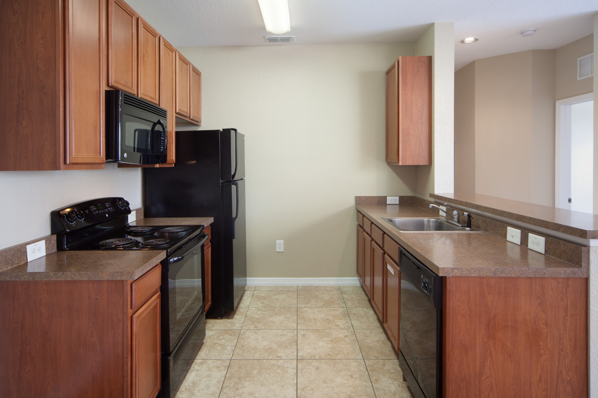 Bella Apartments - Kissimmee, Florida - Black appliances with built-in microwave
