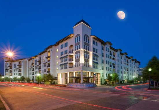 View of the exterior of The Monterey by Windsor Apartments in Dallas TX