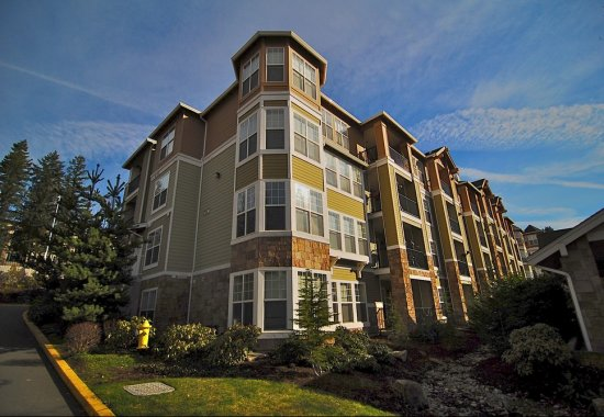 Exterior of building at Reflections by Windsor Apartments in Redmond WA