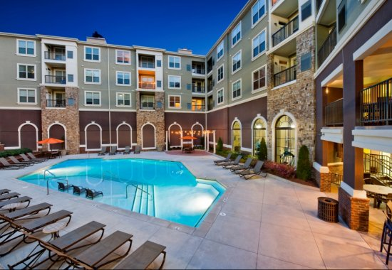 View of swimming pool at Windsor at Glenridge Apartments in Sandy Springs GA